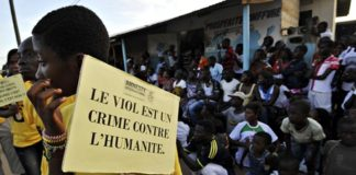 A girl at a rally in Bonoua, south of the Ivorian city Abidjan, holds a placard reading 'Rape is a crime against humanity'. Photograph: Sia Kambou/AFP/Getty Images