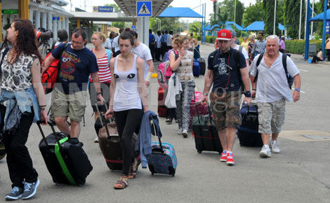 British tourists queue to check in at Moi International Airport after an advisory warning of terrorist attack in Mombasa recently.. [PHOTO: GIDEON MAUNDU/STANDARD]