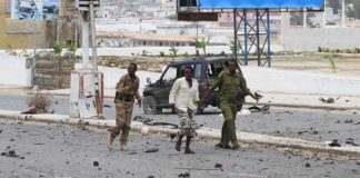 Somali government soldiers walk outside the Parliament during a clash with Al Shabaab militants in the capital Mogadishu last month.