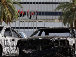 Burnt vehicles at Tripoli airport in the Libyan capital on Monday following fighting between rival armed groups. Photograph: Mahmud Turkia/AFP/Getty Images