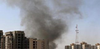 Smoke rises near buildings after heavy fighting between rival militias broke out near Tripoli airport. Photograph: Hani Amara/Reuters