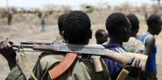 A South Sudanese army (SPLA) soldier holds his rifle near an oil field in Unity state on 22 April 2012 (AP)