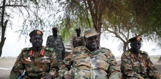Riek Machar, center, attends an interview in Nasir, South Sudan, on April 14. Agence France-Presse/Getty Images