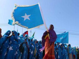 Somali women carrying Somali flag take part in the 56th independent day celebrations in Mogadishu, Somalia. Photo Xinhua, Faisal Isse.