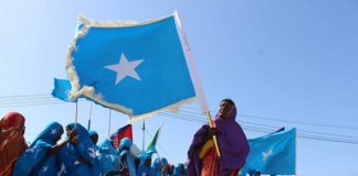 Somali women carrying Somali flag take part in the 56th independent day celebrations in Mogadishu, Somalia. Photo Xinhua, Faisal Isse.