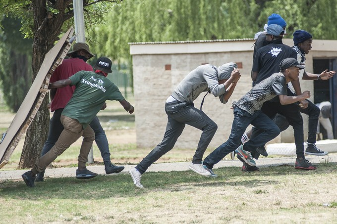 Protesters flee as police open fire with rubber bullets. - Image -  Groundup