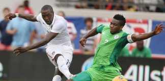 United States player Jozy Altidore scores past Nigerian Joseph Yobo