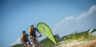 Seen here:  Mountain bikers on the Fruitways Pallet Beach Crossing at Onrust during the 2016 FNB W2W MTB Events.  Photo Credit:  Tobias Ginsberg