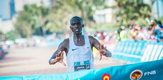 Joshua Cheptegei claims gold at the inaugural FNB Durban 10K CITYSURFRUN in a lightning fast time of 27 minutes 28 seconds.  Photo Credit:  Tobias Ginsberg