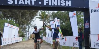 Shaun-Nick Bester (left) and Andrew Hill cross the finish line first at the Zuurberg Mountain Village on the opening stage of the three-day PwC Great Zuurberg Trek mountain-bike race at Addo, 70km outside Port Elizabeth, today. Picture: Full Stop Communications