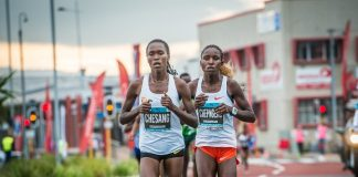 Seen here (left to right):  Stella Chesang and Jackline Chepngeno in action at the 2018 FNB Cape Town 12 ONERUN.  Chesang finished 2nd behind Chepngeno on the day.  Photo Credit:  Tobias Ginsberg