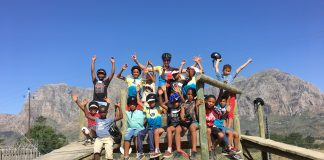 Seen here: The children from the Aitsa After Care Centre with their mountain biking coach, Bianca Grobbelaar.