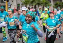 Seen here: Running enthusiasts enjoying the action of the 2018 FNB Cape Town 12 ONERUN. Photo Credit: Mark Sampson