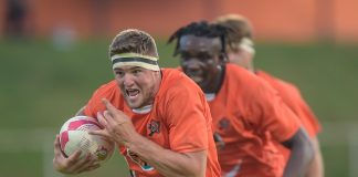 University of Johannesburg captain Adriaan Bester bursts through on his way to scoring a try in their Varsity Cup rugby match against Wits at the UJ Stadium in Johannesburg on Monday. UJ won 39-16. Photo: Christiaan Kotze/SASPA