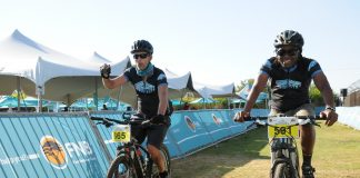 Seen here (from left to right): Michael Wright and Edwin Kgaswe crossing the finish line at the 2018 FNB Magalies Monster MTB Classic. Photo Credit: Jetline Action Photo