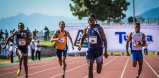 Seen here: Sinesipho Dambile (Race No 318 /Athletics Gauteng North) charged to a stunning victory in the youth boys 200m final, clocking 20.68 seconds to finish 0.81 ahead of his nearest competitor.Photo Credit: Tobias Ginsberg