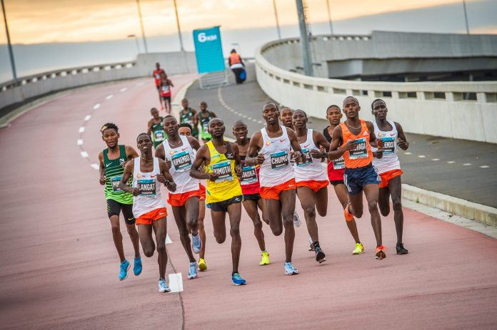 Seen here (far left):  Kenyan John Langat in action during the 2018 FNB Cape Town 12 ONERUN.Photo Credit:  Tobias Ginsberg