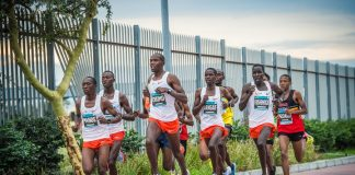 Seen here (far left): Abdallah Mande in action during the 2018 FNB Cape Town 12 ONERUN.Photo Credit: Tobias Ginsberg