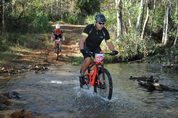Seen here: Raymond Travers crossing the finish line at the 2018 FNB Magalies Monster MTB Classic. Photo Credit: Jetline Action Photo