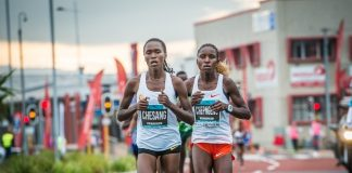 Seen here (from left to right): Stella Chesang and Jackline Chepngeno in action during the 2018 FNB Cape Town 12 ONERUN.Photo Credit: Tobias Ginsberg