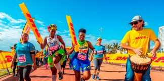 Seen here: Runners having a blast on route at the 2018 FNB Durban 10K CITYSURFRUN. Photo Credit: Anthony Grote
