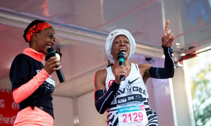 Seen here (from left to right): Phindi Gule-Burley with road running legend Blanche Moila at the 2018 Totalsports Women's Race. Photo Credit:  Rogan Ward
