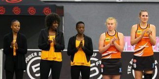 University of Johannesburg members (from the left) Liphiwe Nxasana (sport scientist), Nomsa Zungu (assistant coach), Bongiwe Msomi (coach) and players Twanette Thoms and Kendra Szeles take part in the opening ceremony for one of their Varsity Netball matches. Photo: Van Zyl Naude