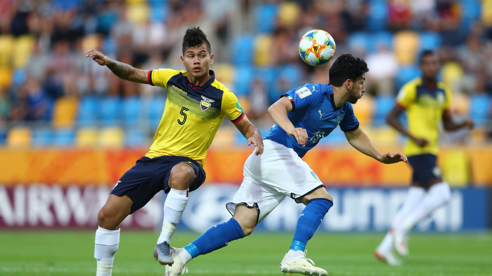 Jordy Alcivar of Ecuador battles for possession with Roberto Alberico of Italy