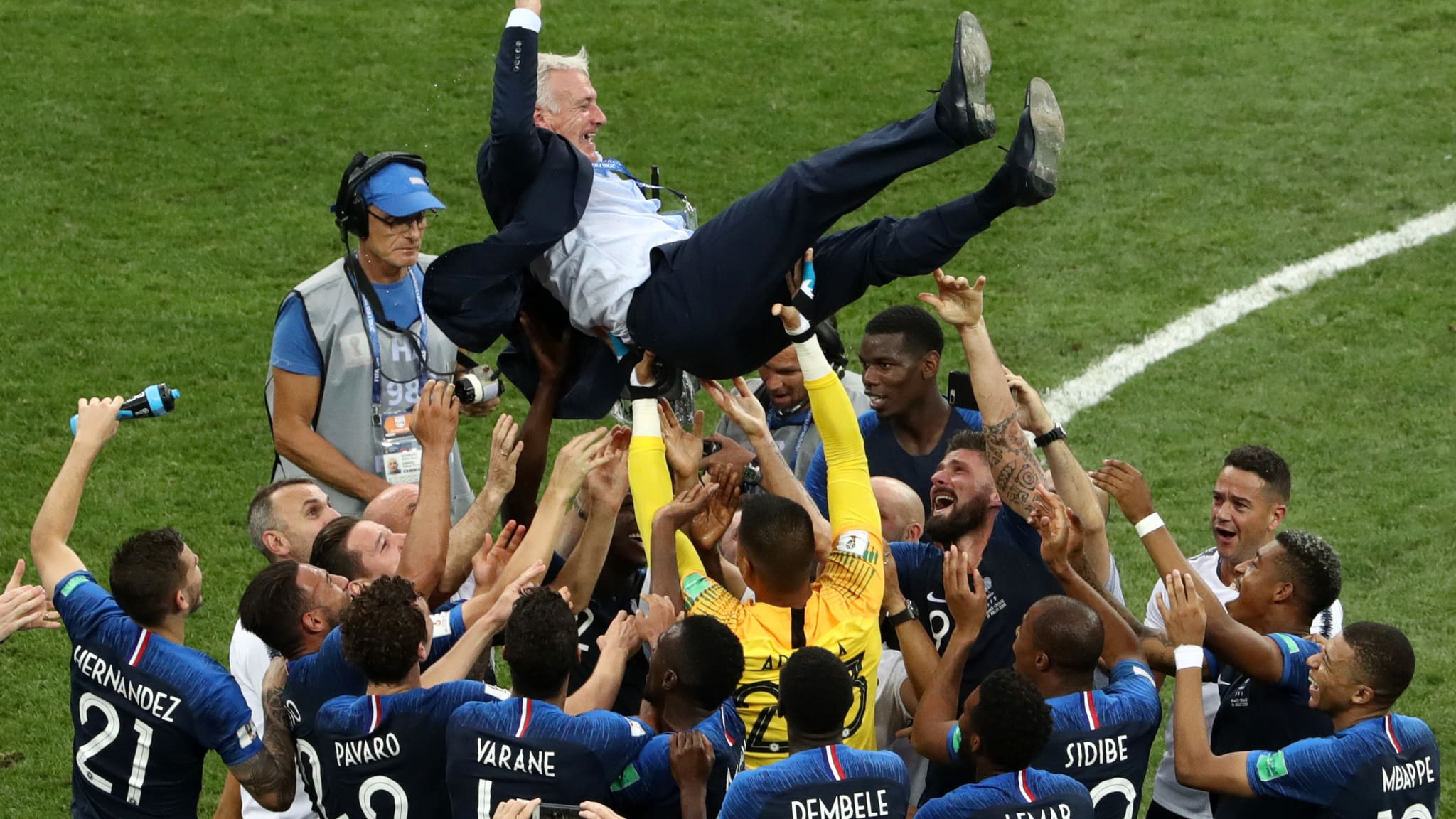 France players celebrate with Didier Deschamps, Manager of France following their sides victory in the 2018 FIFA World Cup Final