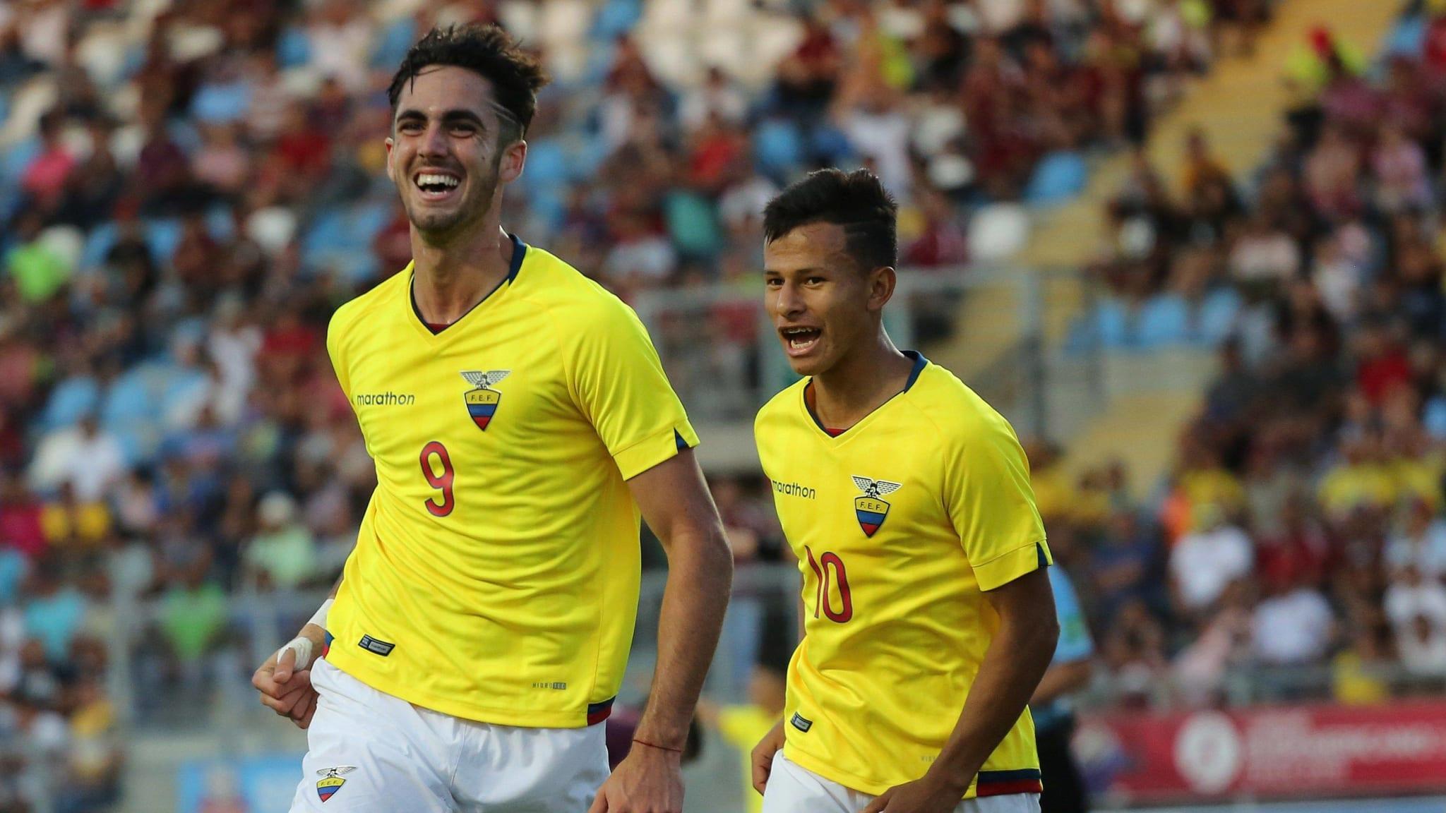 Leonardo Campana (L) of Ecuador celebrates after scoring against Venezuela