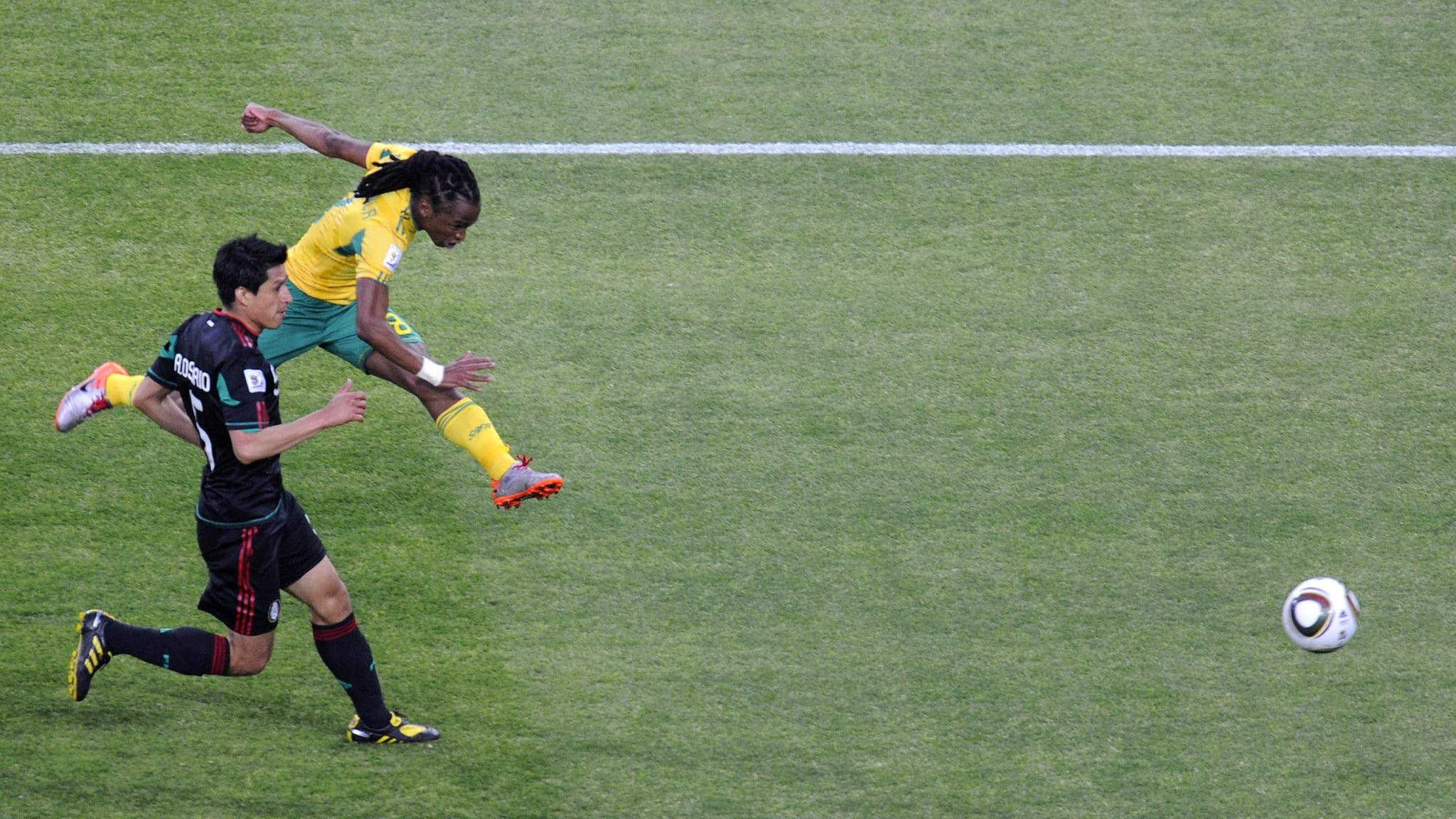 June 11, 2010: Siphiwe Tshabalala of South Africa (RSA, yellow) scores during a group A match of the 2010 FIFA World Cup against Mexico at Soccer City stadium in Soweto.