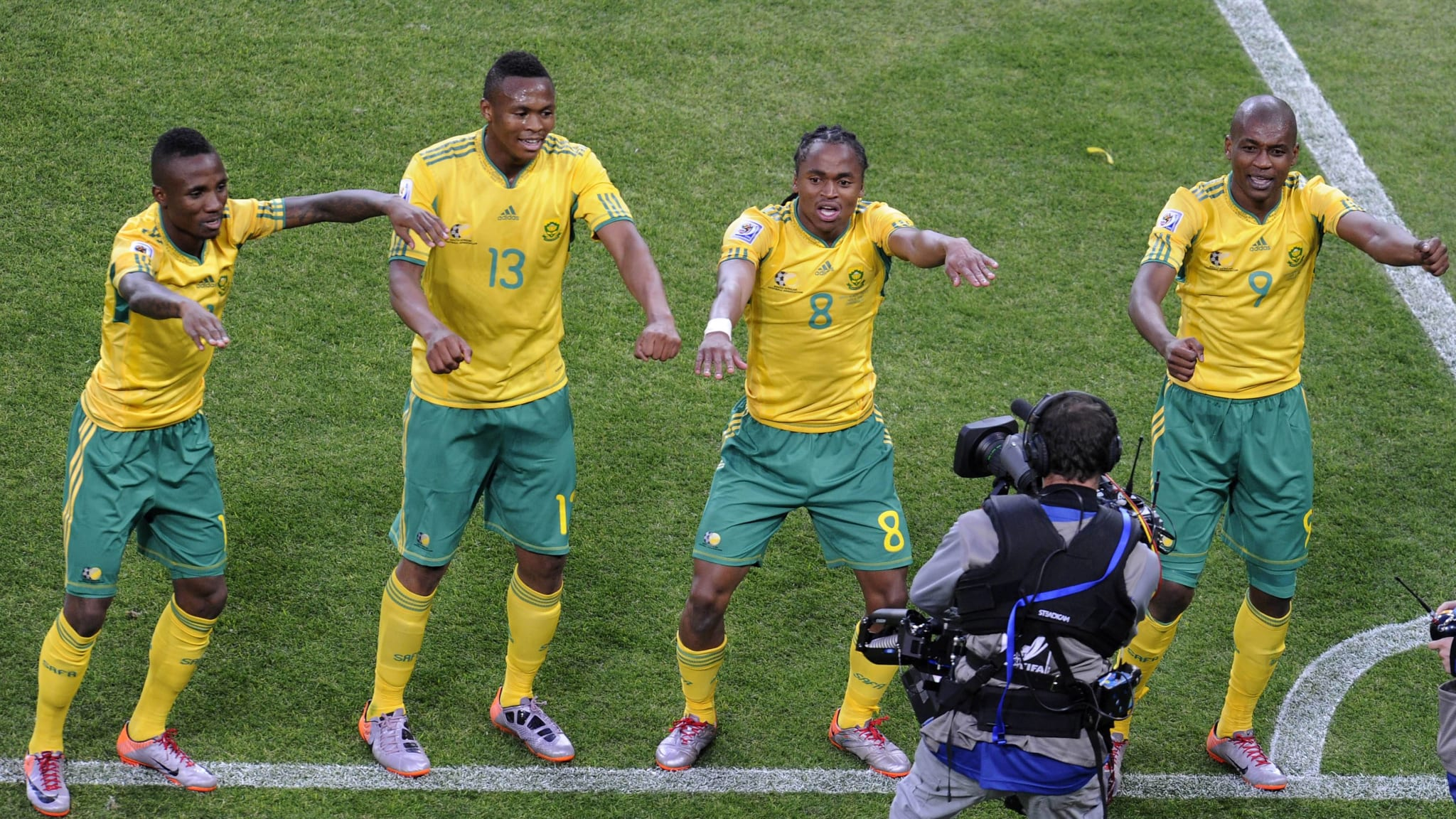 June 11, 2010: Siphiwe Tshabalala of South Africa (RSA, yellow) celebrates his goal during a group A match of the 2010 FIFA World Cup against Mexico at Soccer City stadium in Soweto