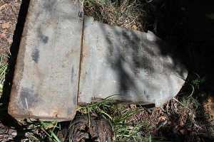 Original headstone where it was discarded