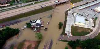 Flood waters cover the area of FM 1463 at IH-10 in Fort Bend County, Texas, U.S. April 19, 2016. Texas DOT-Houston/Handout via REUTERS