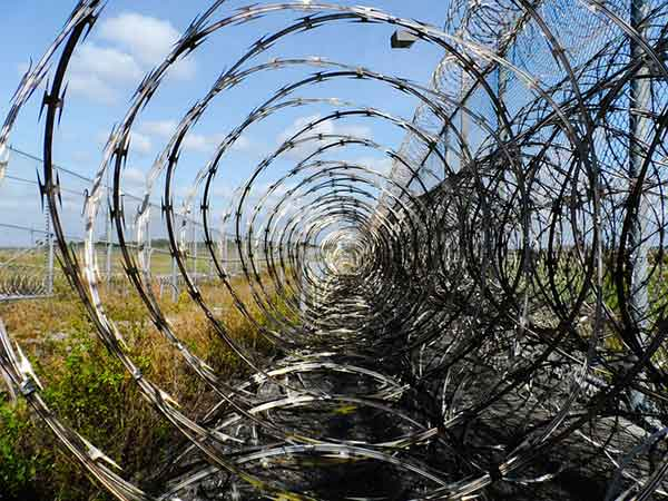 barbed wire fence prison. Prison-fence-barbed-wire Barbed Wire Fence Prison I