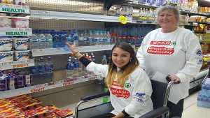 Sumaiyah Abrahams from Continental Tyres (left), assisted by her colleague Ansie van der Merwe, complete one of the tasks during the launch of the SPAR Wheelchair Wednesday. Photo: Full Stop Communications