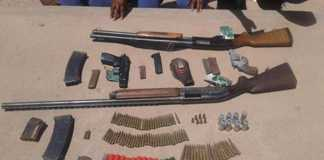 Two men arrested for unlicensed firearms. Photo: SAPS