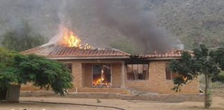Public violence and burning of houses outside Lebowakgomo. Photo: SAPS