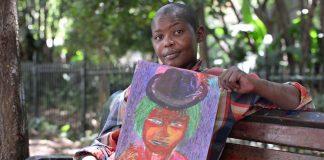 Street artist Chuma Somdaka with her art
