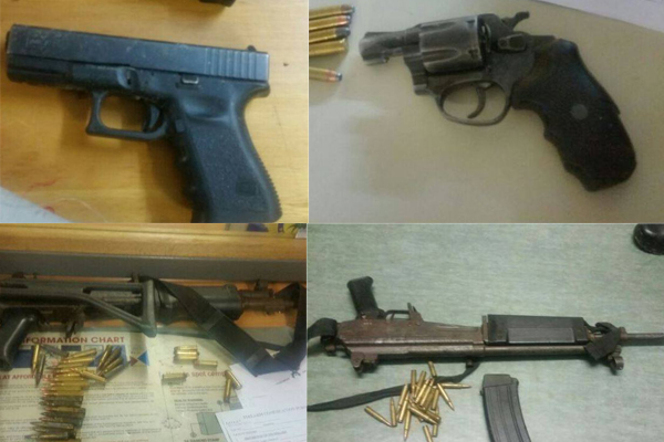 Automatic weapons amongst firearms recovered, 4 arrested. Photo: SAPS
