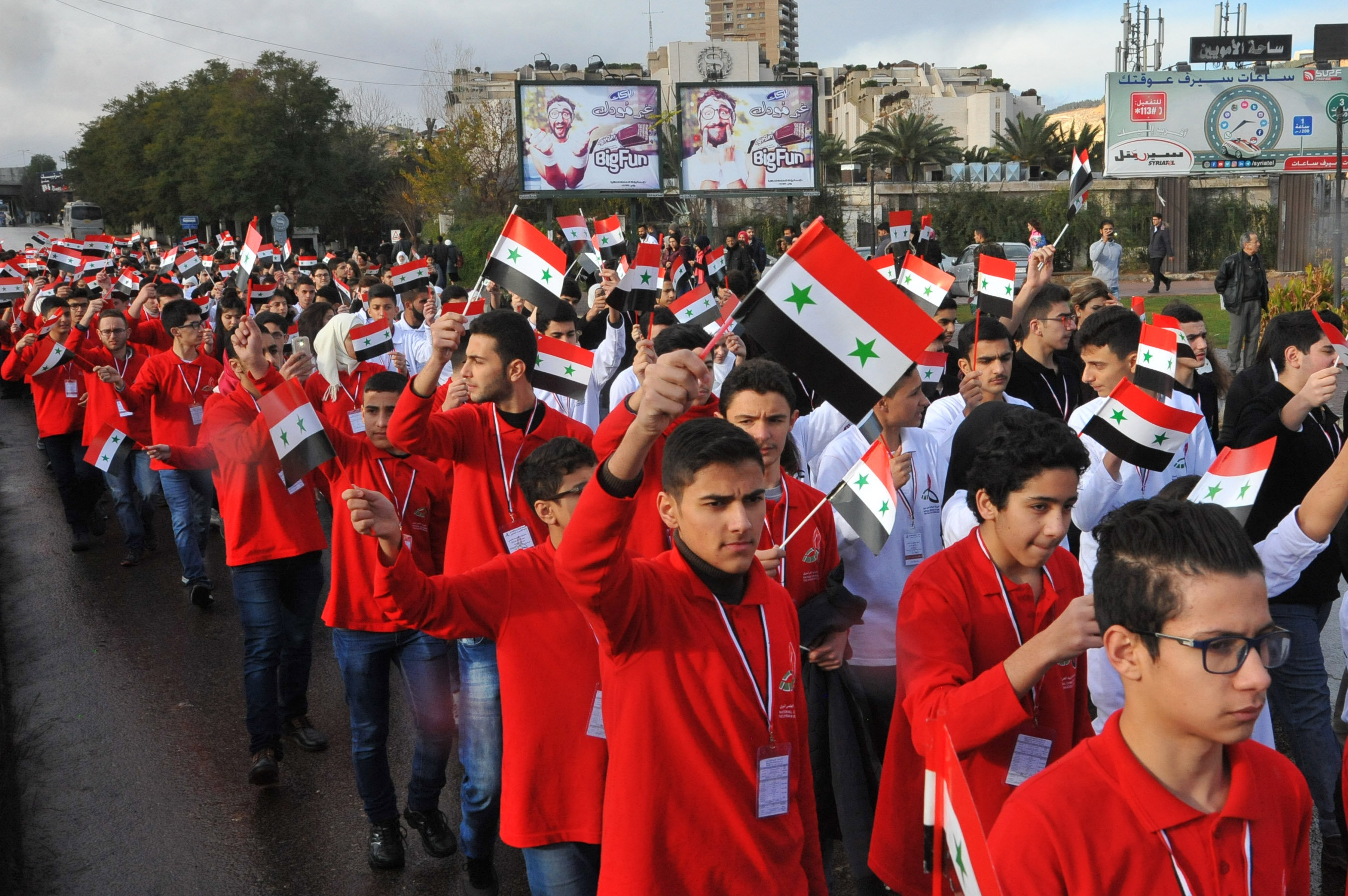Students marching through Damascus following the final round of competition.