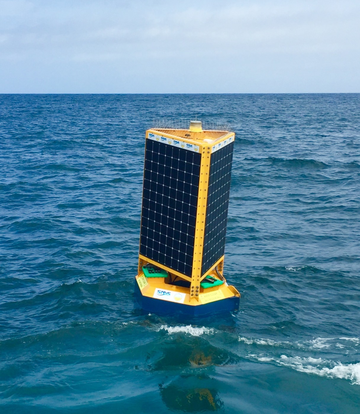 The floating Clever Buoy tested at Bondi Beach near Sydney, Australia. The buoy is connected to sonar units installed on the sea floor.