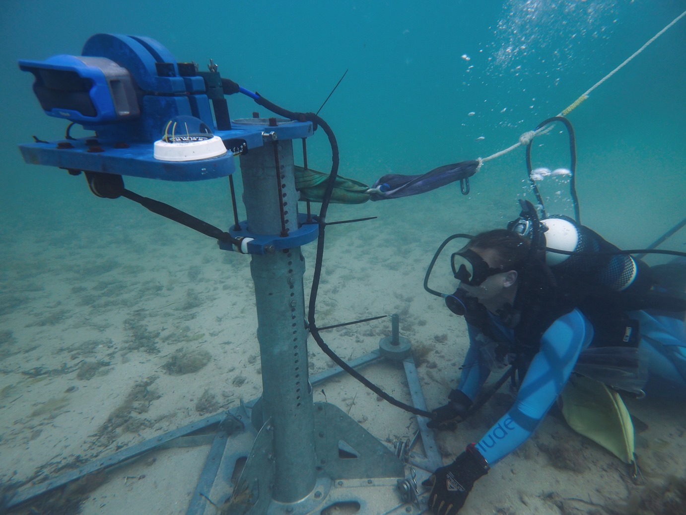 Installing the seabed frame with the sonar transducer on the ocean floor.
