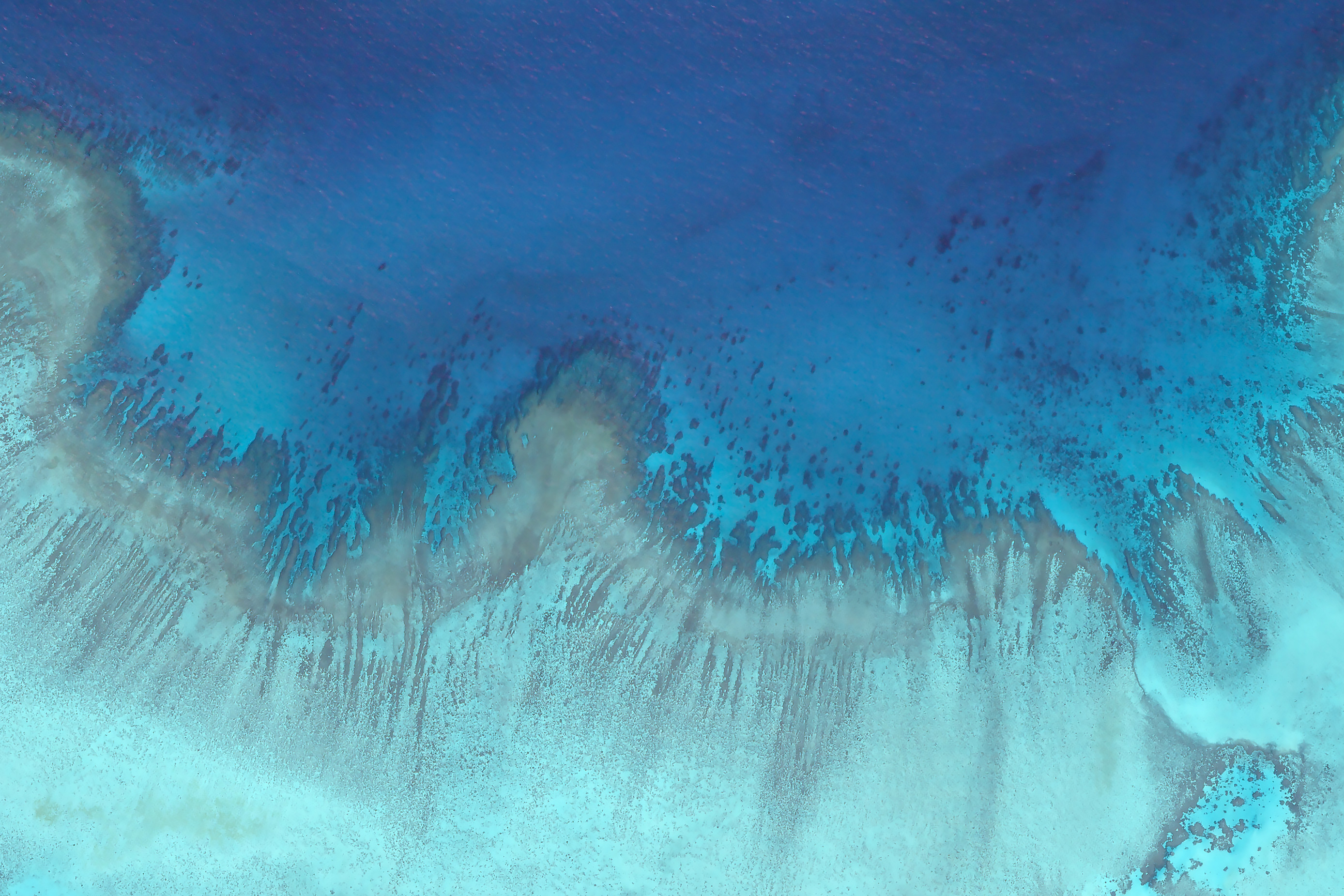 """Planet satellite image of Heron Island. """"We need to know what is occurring in this hidden world of shallow coral reefs if we  have any hope to save them,"""" said Art Min, vice president of impact for Paul Allen Philanthropies, in a statement. """"Coral reefs cover less than 1 percent of the ocean surface and yet nearly 1 billion people and 25 percent of all marine life depend on them."""""""