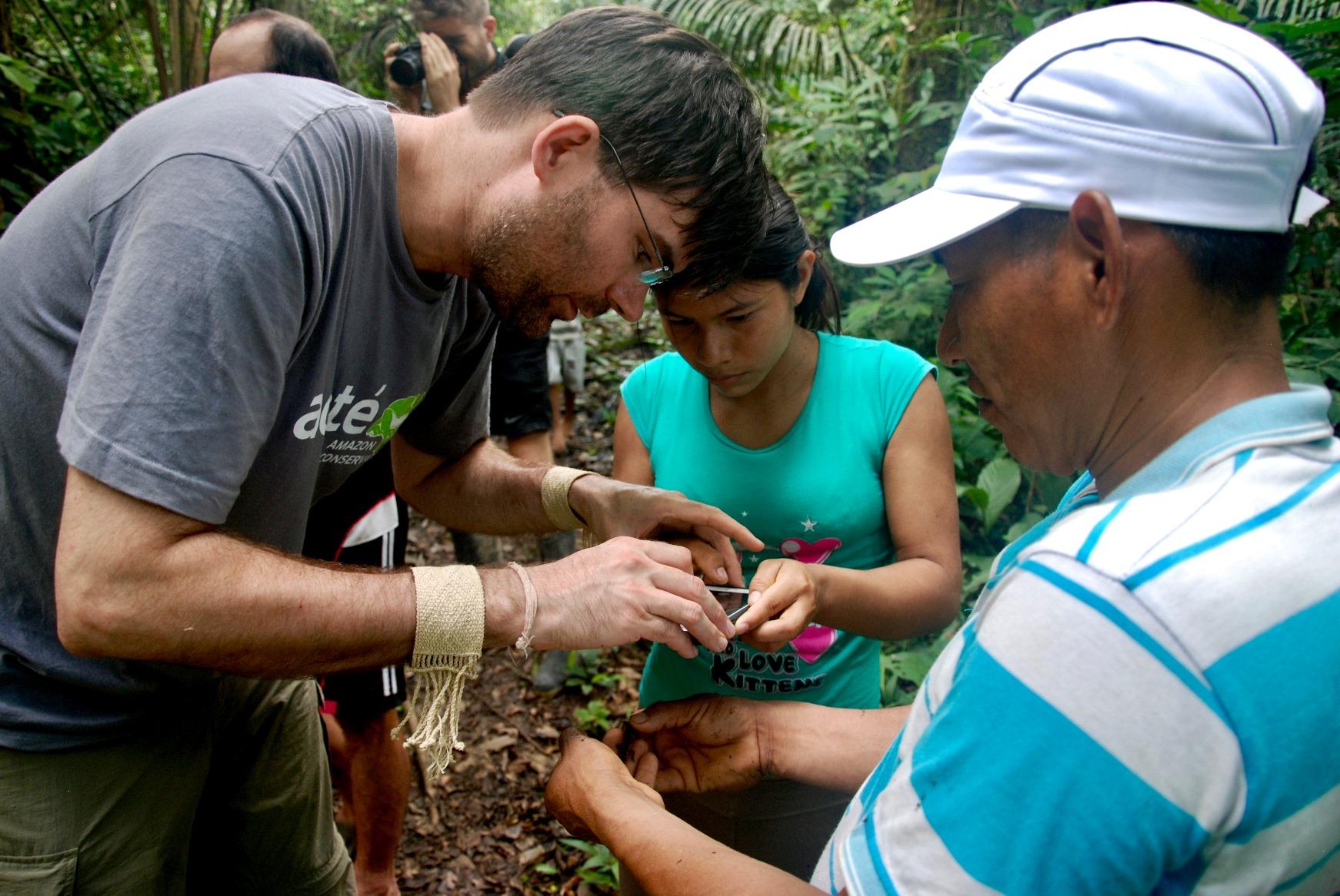 Acaté's president Christopher Herndon and Matsés residents Casilda Jiménez and Segundo Shabac Reyna Pérez developing the pilot herpetological inventory near Estirón village.
