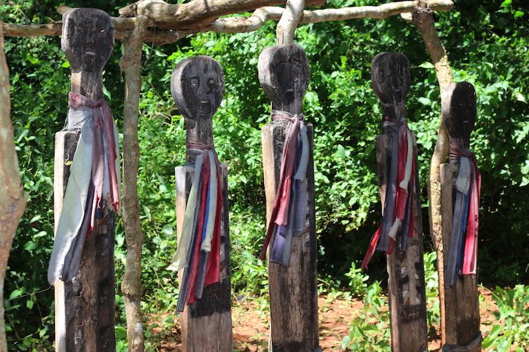 The carved ancestors of the Kauma Clan stand guard inside Kaya Kauma. Image by Sophie Mbugua for Mongabay.