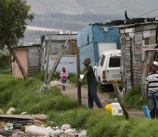 A large number of poor South Africans live in informal settlements. EPA/Nic Bothma