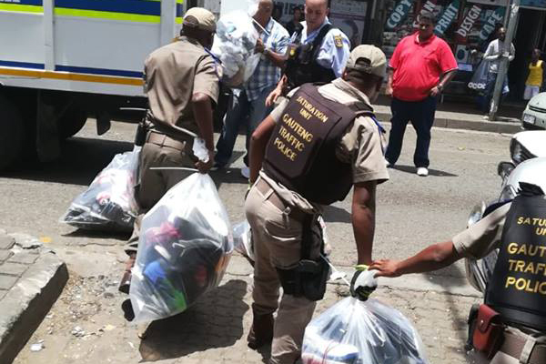Police recover counterfeit goods worth R5.6 mill, Hillbrow. Photo: SAPS
