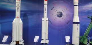 Scale models of rockets at China Aerospace Science and Technology Corporation's booth at the International Astronautical Congress. FOCKE STRANGMANN/EPA