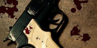 Man dies in business robbery, policeman wounded, suspect killed